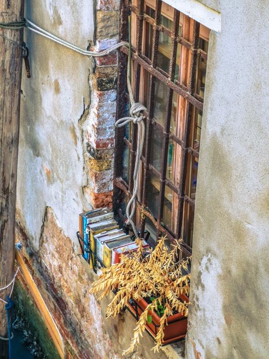 Books of the Libreria Acqua Alta bookshop in Venice Italy. Such a unique place, even the window sill has books stored on it.