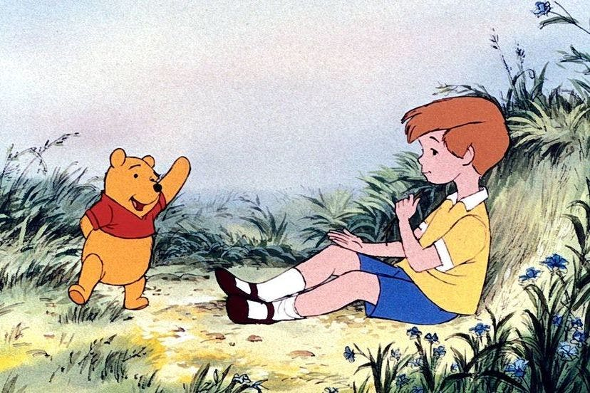 Winnie the Pooh and Christopher Robin, A.A. Milne's loveable main characters. Along with friends Eeyore and Piglet